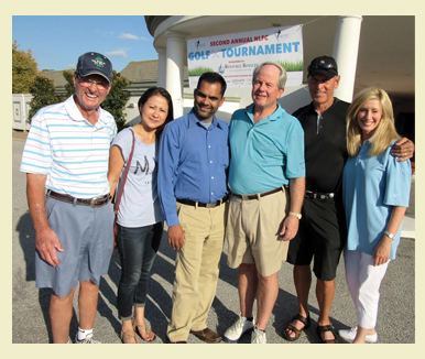 Grace Road Ministries golf tournament photo of sponsors and participants with dan and norola happy smiling people